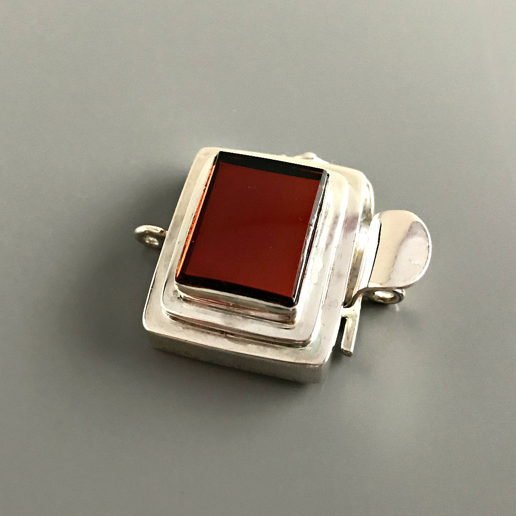 "The rich, ""Rootbeer"" brown color of the cabochon in this Suzie Q Studio box clasp has a mirror finish at the base of it, which makes it very versatile to create a casual, organic piece or something more ""upscale"". It looks wonderful with the faceted, dark carnelian stone beads shown in one of the images here."