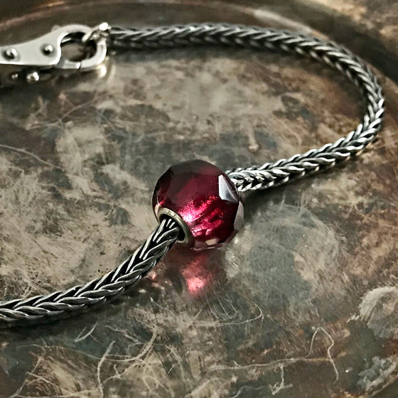 Suzie Q Studio has a treasure vault full of Rare & Retired Trollbeads... and we're making them available to you. We're starting with our Rare & Retired Glass Beads. The prism in this red and pink glass bead reflects light in a thousand different directions and is reminiscent of a juicy pomegranate seed!