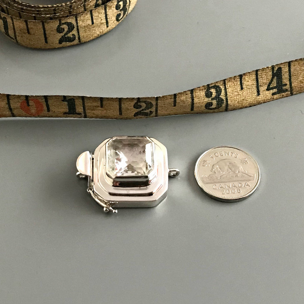 "This Suzie Q Studio custom box clasp was handcrafted with a gorgeous, faceted glass cabochon, which is set in a substantial amount (more than average) of sterling silver. Its classic crystal color means that it'll turn almost any jewelry design into a total ""head-turner""!"