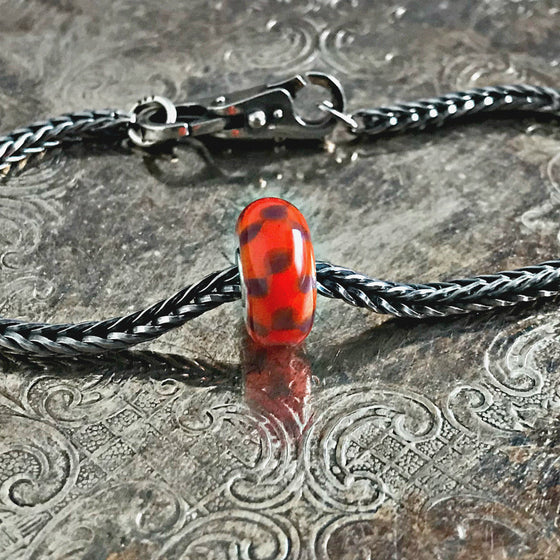 Suzie Q Studio has a treasure vault full of Rare & Retired Trollbeads... and we're making them available to you. We're starting with our Rare & Retired Glass Beads.This rare Trollbead has checkered pattern in red and purple. Two colours complementing each other very well, making the pattern almost three-dimensional.