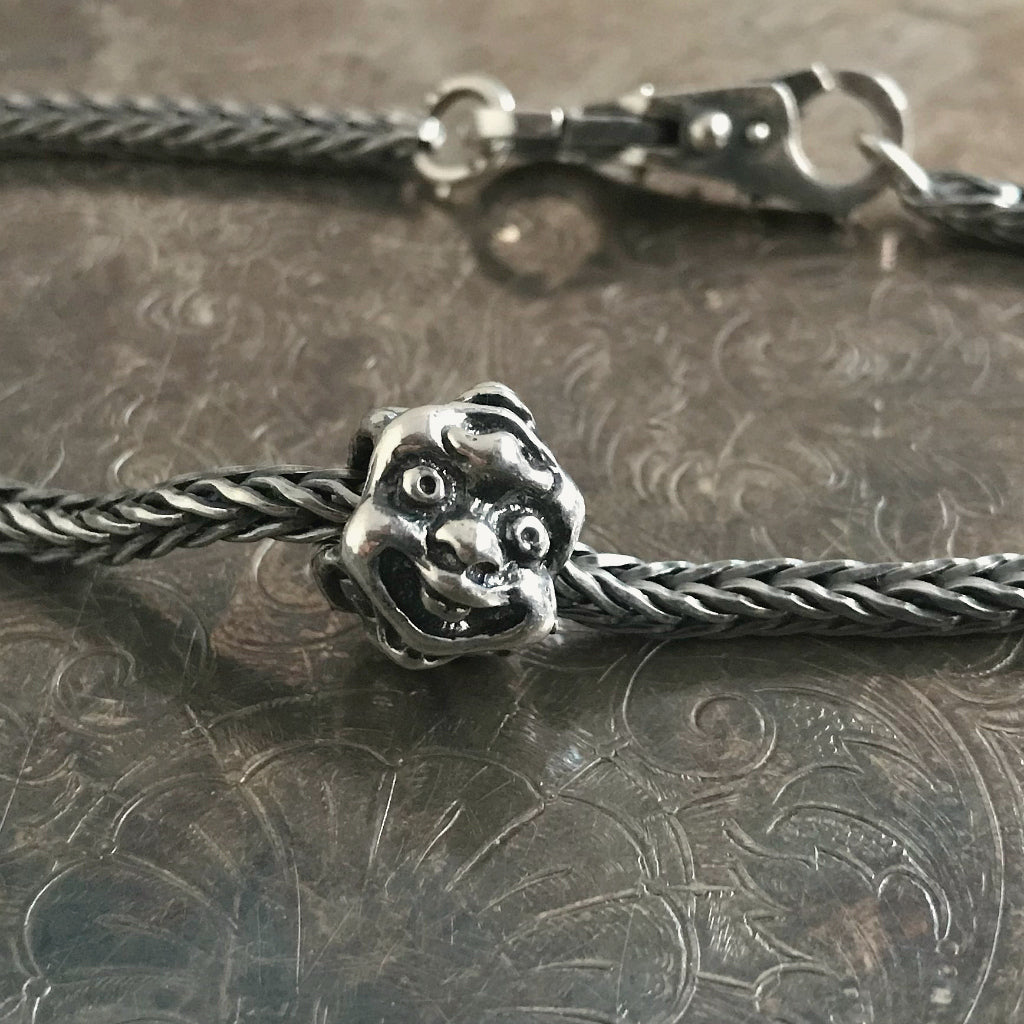 Suzie Q Studio has a treasure vault full of Rare and Retired Trollbeads... and we're making them available to you. The rare EIGHT FACES Trollbead is incredibly intricate… Eight different faces show when you turn this Trollbead, each sharing its mouth with another face!