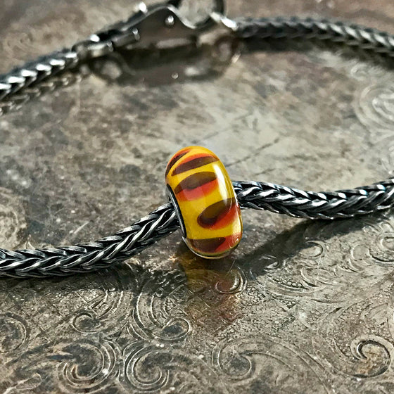 Suzie Q Studio has a treasure vault full of Rare & Retired Trollbeads... and we're making them available to you. We're starting with our Rare & Retired Glass Beads. Like an exotic fruit from the Garden of Eden, this Trollbead is sweet and juicy... it entices all your senses.