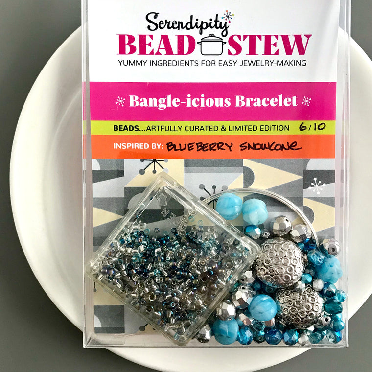 Suzie Q Studio's Serendipity BEAD STEW DIY EASY BANGLE STYLE BRACELET MAKING KITS are limited edition collections of artfully curated premium quality beads and components for you to make a one-of-a-kind bracelet that'll have that super-cool look of multiple bangles stacked on your wrist. No experience needed! Seeing this color combo in the Blueberry Snow Cone kit, can't help but remind you of that icy-cool, summery treat… A blueberry snow cone!