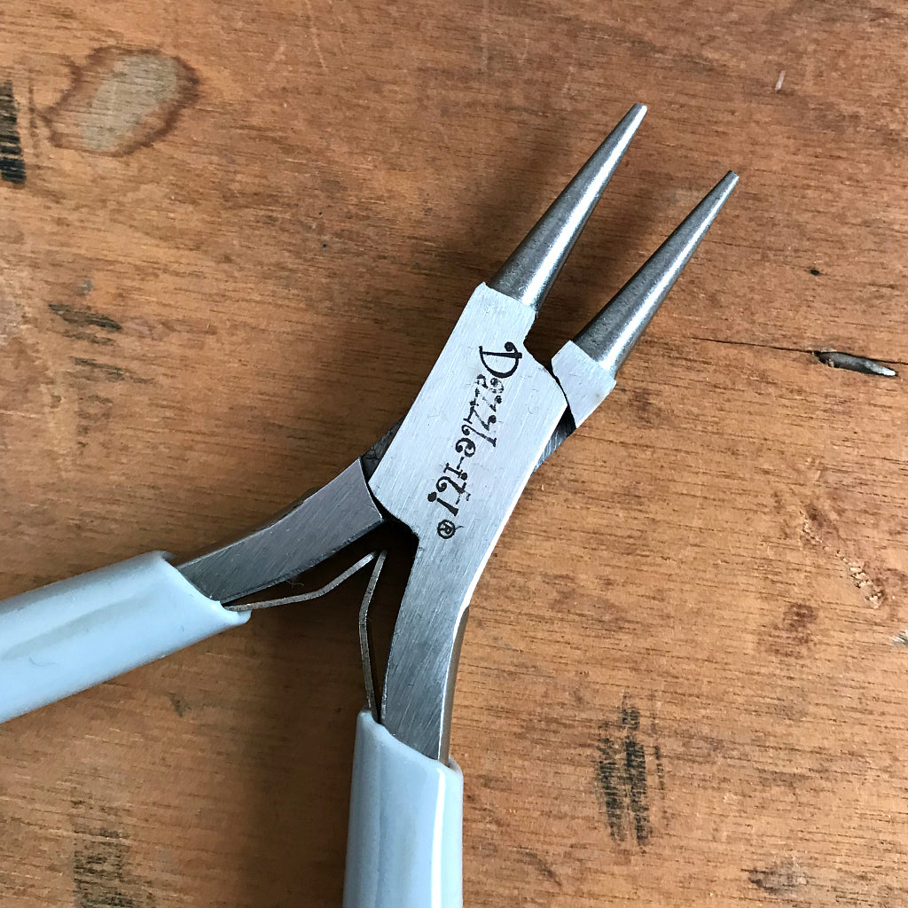 "This Suzie Q Studio ""Round Nose Plier"" is used for shaping wire into round loops and curves, which is why it's an essential tool to make a BEAD STEW bracelet because you use it to create a loop to close off the end of your bracelet. This will stop the beads from sliding off the end of the memory wire."