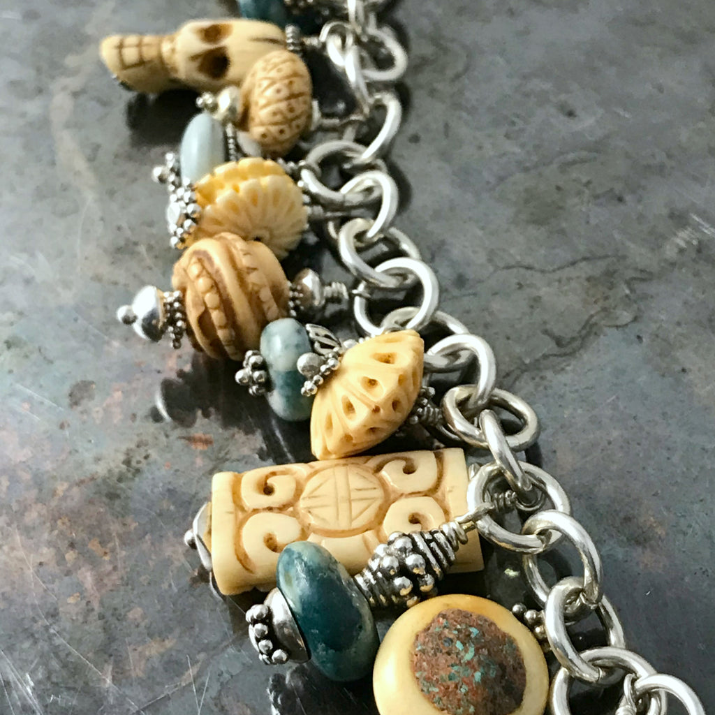 TURQUOISE AND CARVED BONE CHARM BRACELET