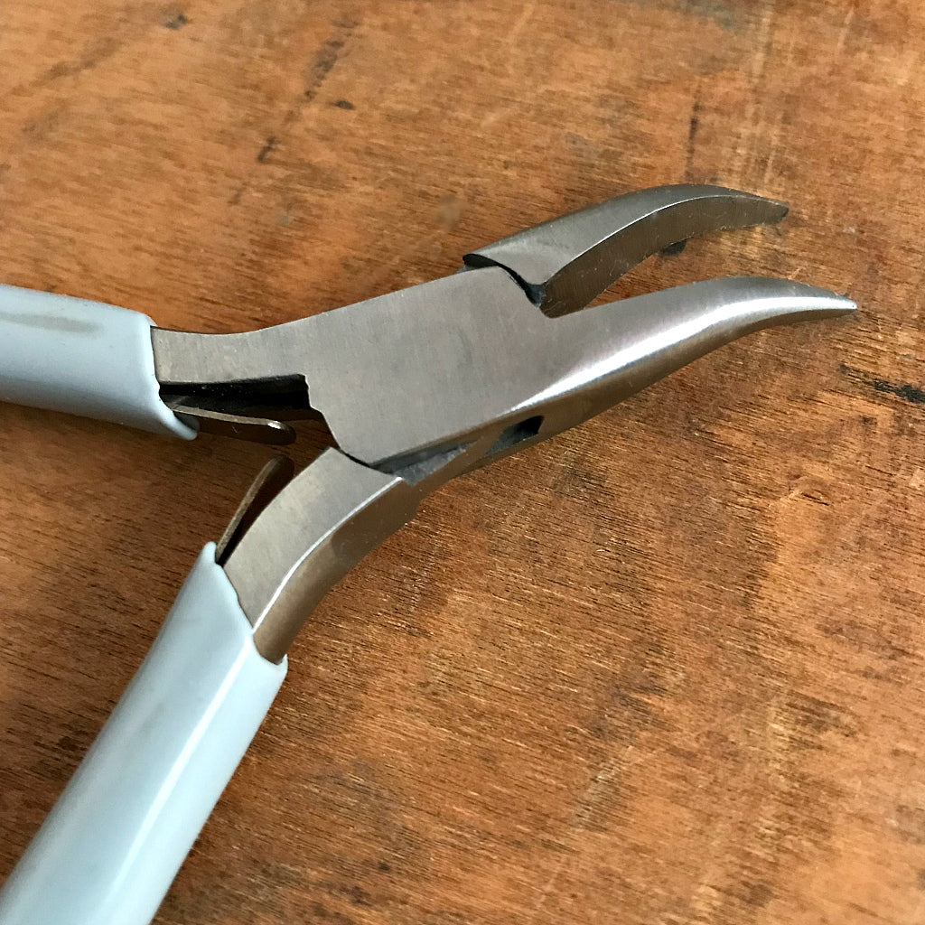 "When it comes to making jewelry, if you want professional looking results, using Suzie Q Studio's jewelry-making tools is the way to go! The ""Bent Chain Nose Plier"" is ideal for griping and bending. As well, because of their extra-pointy nose and curved jaws, they're able to get into even tighter spots than the regular Chain Nose Plier!"