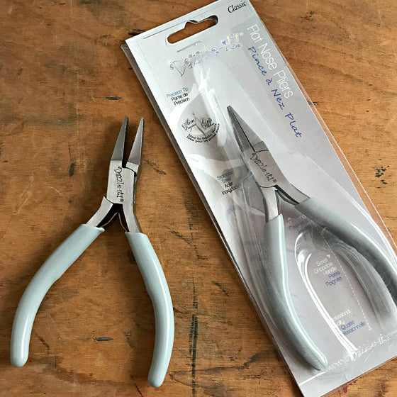 "When it comes to making jewelry, if you want professional looking results, using Suzie Q Studio's jewelry-making tools is the way to go! The non-tapered tip and wide surface area of this ""Flat Nose Plier"" makes it easier to grip jewelry wire and secure components, as well as being great to finish wire-wrapped ends."