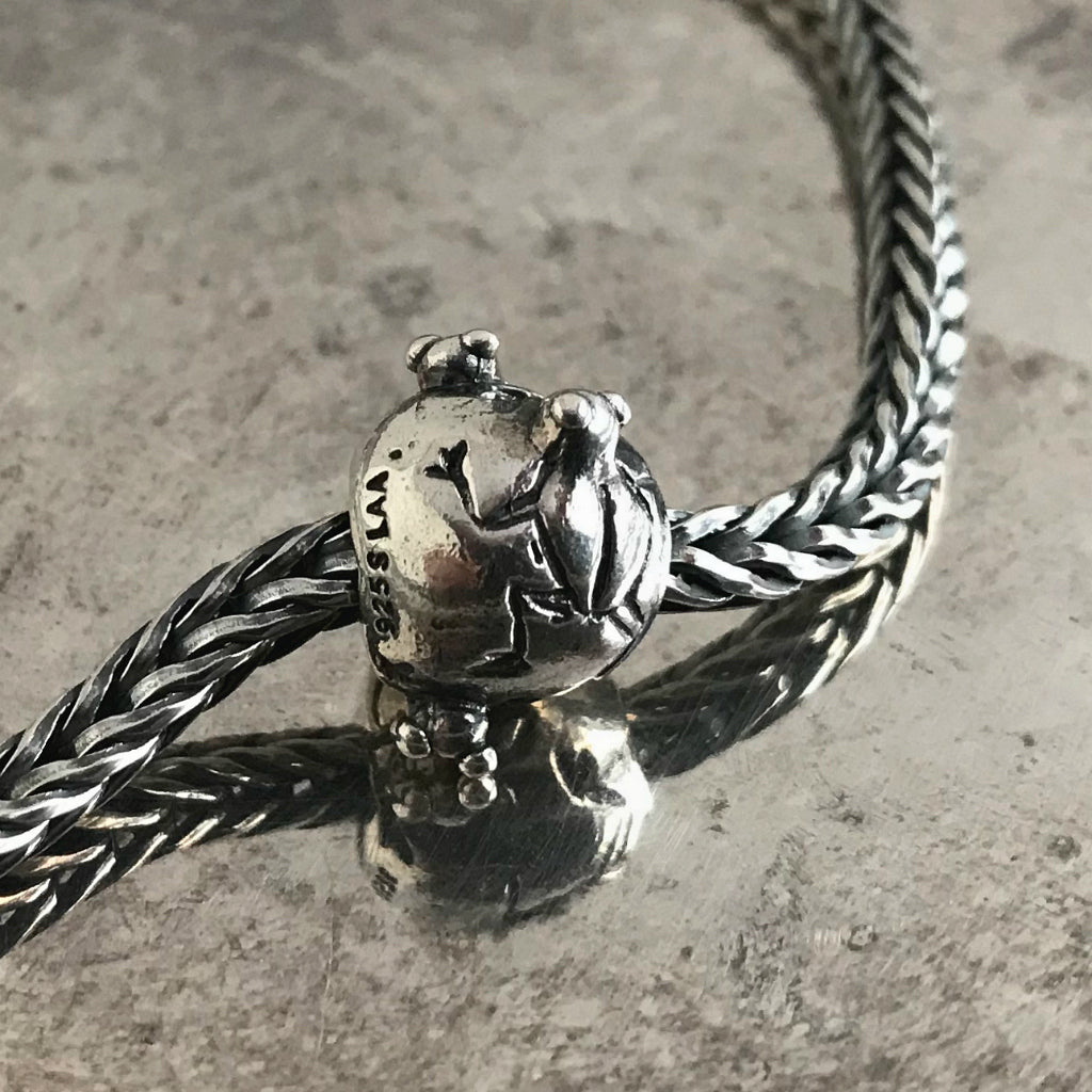 Suzie Q Studio has a treasure vault full of Rare and Retired Trollbeads... and we're making them available to you. This rare, retired Sterling Silver Trollbead is decorated with frogs poking their heads out of the water, reflecting an image which Native Americans in the Southwest used to decorate their pottery.