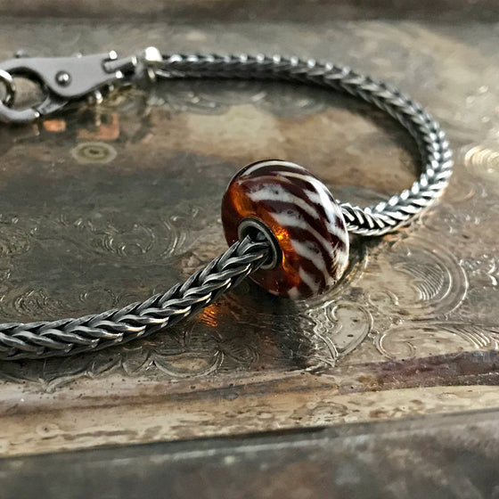"Suzie Q Studio has a treasure vault full of Rare & Retired Trollbeads... and we're making them available to you. We're starting with our Rare & Retired Glass Beads. We'll be adding lots more so check back often. This glass bead looks like it's ""covered"" with fur... fun and elegant at the same time."