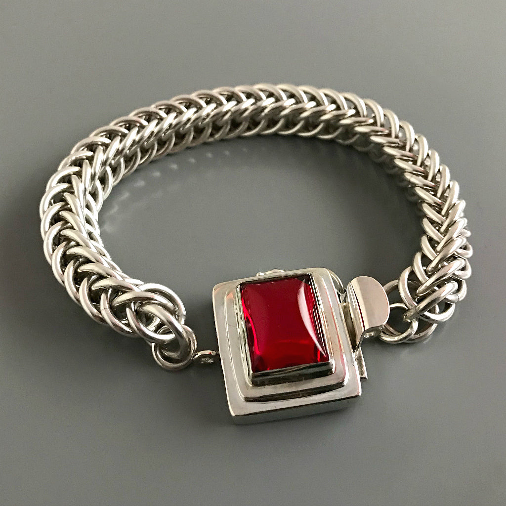 If you love red, this Suzie Q Studio box clasp is for you The color is absolutely scrumptious - not too orangey or too bluish! This custom box clasp was handcrafted with a vintage glass cabochon and set in a substantial amount of sterling silver to create a statement-making piece of jewelry.