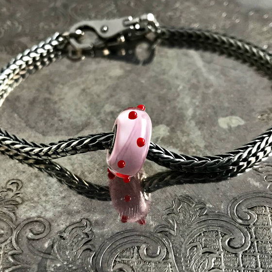 "Suzie Q Studio has a treasure vault full of Rare & Retired Trollbeads... and we're making them available to you. We're starting with our Rare & Retired Glass Beads. We'll be adding lots more so check back often. Who doesn't love ""polka dots""?! Give this happy Trollbead to the one you love, to a very good friend or a special treat for yourself!"