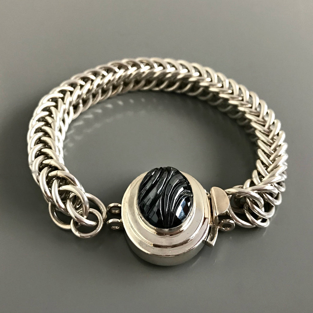 "This Suzie Q Studio double-strand custom box clasp was handcrafted with an exquisite, oval-shaped ""carved"" vintage glass cabochon in a hematite stone-style finish and set in a substantial amount (more than average) of sterling silver, which gives this fab closure a look that can be casual, classic or totally upscale... The choice is yours!"