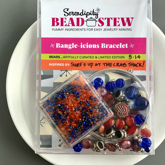 Suzie Q Studio's Serendipity BEAD STEW DIY EASY BANGLE STYLE BRACELET MAKING KITS are limited edition collections of artfully curated premium quality beads and components for you to make a one-of-a-kind bracelet that'll have that super-cool look of multiple bangles stacked on your wrist. No experience needed!  The SURF'S UP AT THE CRAB SHACK! kit contains various shades and tones of orangey-reds, cobalt blue, metallic silver, with a hint of mauve which will make you think of being at the beach.