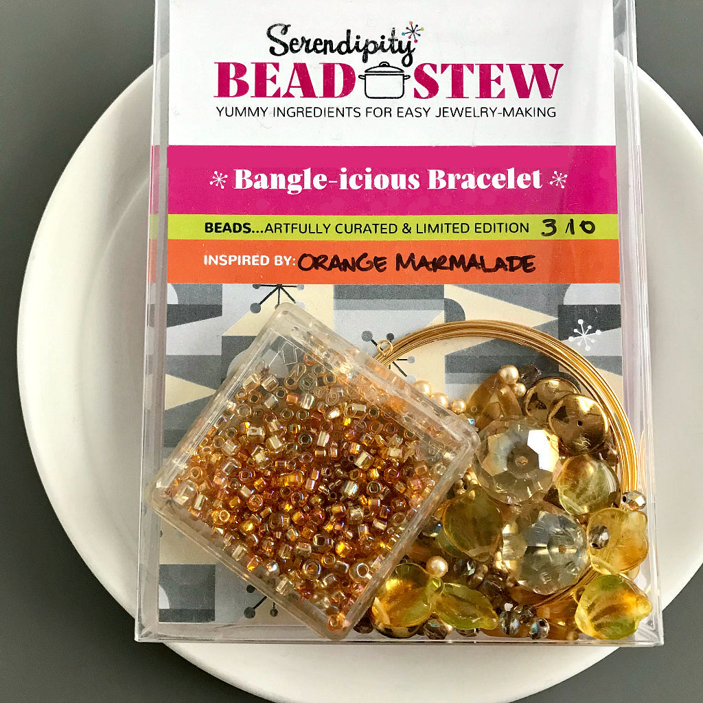 Suzie Q Studio's Serendipity BEAD STEW DIY EASY BANGLE STYLE BRACELET MAKING KITS are limited edition collections of artfully curated premium quality beads and components for you to make a one-of-a-kind bracelet that'll have that super-cool look of multiple bangles stacked on your wrist. No experience needed! This sparkly ORANGE MARMALADE bracelet kit contains yellowy-orange, topaz, light topaz, pale chartreuse, matte and shiny gold, metallic bronze, and crystal golden shadow beads.