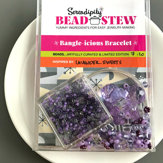 "Suzie Q Studio's Serendipity BEAD STEW DIY EASY BANGLE STYLE BRACELET MAKING KITS are limited edition collections of artfully curated premium quality beads and components for you to make a one-of-a-kind bracelet that'll have that super-cool look of multiple bangles stacked on your wrist. No experience needed!  ""Lavender Sweets"" Kit: contains Various shades and tones of lavender and violet, clear crystal, metallic purple and matte, pale blue"