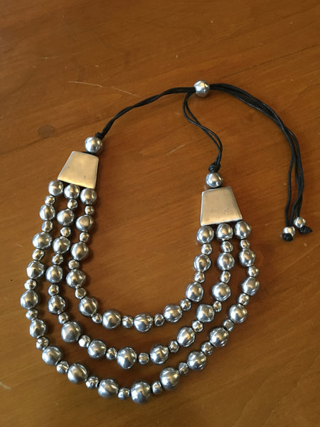 682  Adjustable aluminum three thread necklace with balls.
