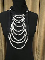 Adjustable long multi thread jersey and aluminum balls necklace.