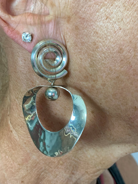 "Sterling Silver spiral post hammered earrings, total length 2""."