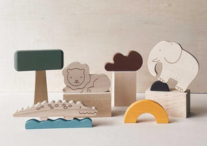 Wooden crafted elephant, lion, and crocodile with safari scenery pieces.