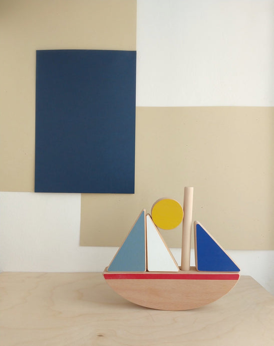 Wooden crafted sail boat stacking and balancing toy.