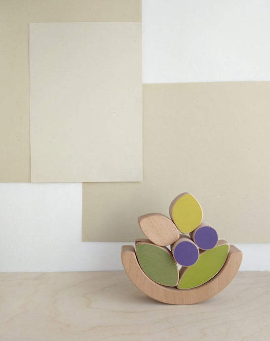 Wooden crafted leaves and blueberries stacking and balancing toy.