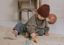 Load image into Gallery viewer, A child is playing with wooden crafted safari pieces.