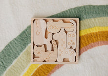 Load image into Gallery viewer, Handcrafted wooden animals fit in a puzzle block.