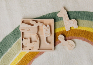 Handcrafted wooden animals and puzzle block.