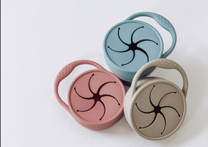 Silicone snack cups in dusty rose, dusty blue, latte.