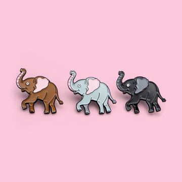brown, gray and blach Elephant pins in a row