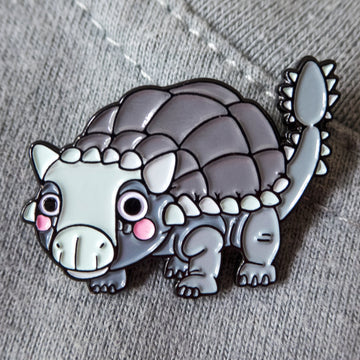 Ankylosaurus pin on gray sweater