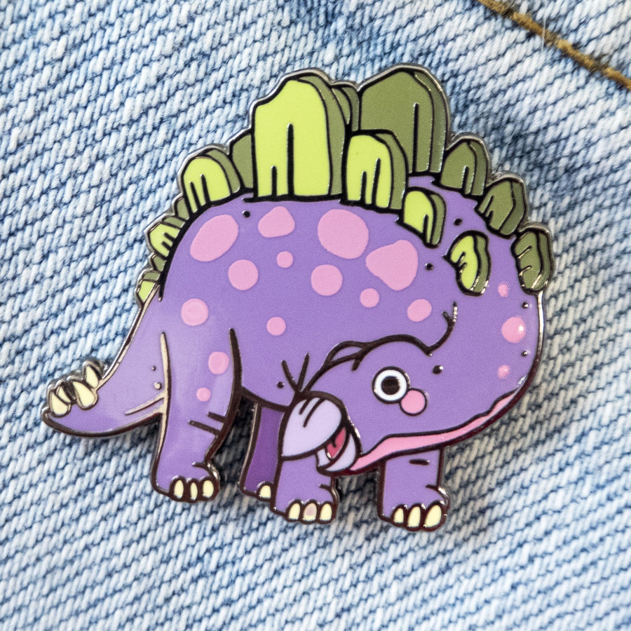 baby stegosaurus pin on light denim