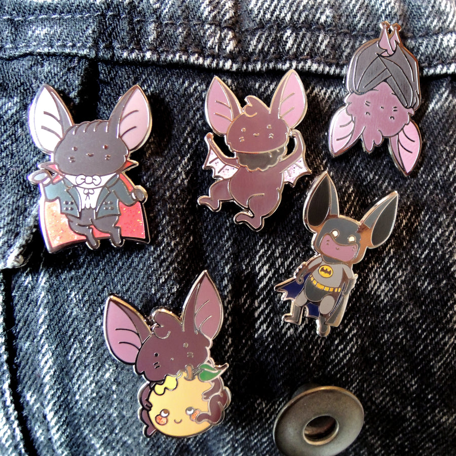 bat pins on black denim