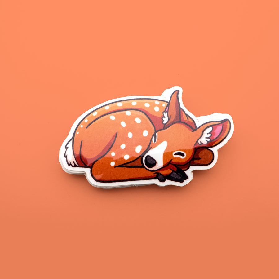 red baby deer taking a nap sticker