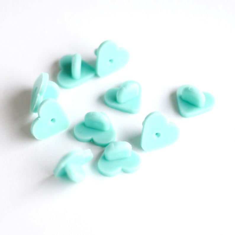 mint heart shaped rubber badge back