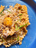 Kimchi Carbonara with Mafaldine and a Smoked Egg Yolk