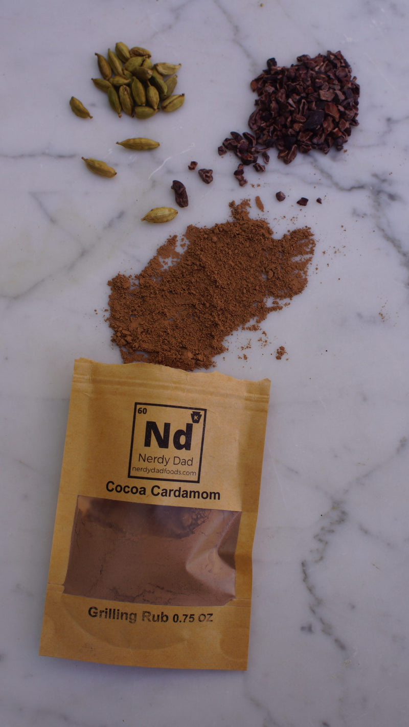 ingredients spilled out of cocoa cardamom rub