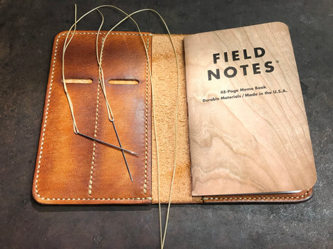 Leather field notes cover hand stitched waxed linen thread saddle stitch harness stitched
