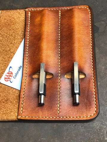 Brown leather field note journal cover with pen holder's hand made by Marty Flint