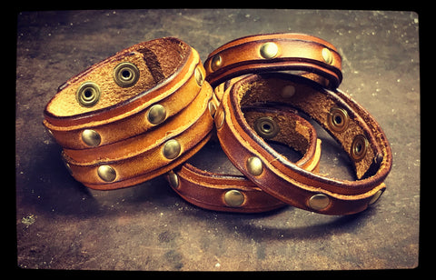 Brown leather and brass rivet bracelets