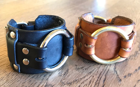 Black and brown leather bracelets with large brass ring and buckle