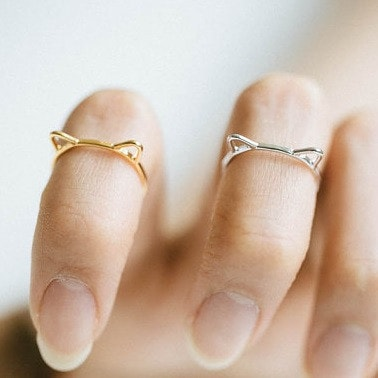 silver and gold knuckle rings shaped like cat ears