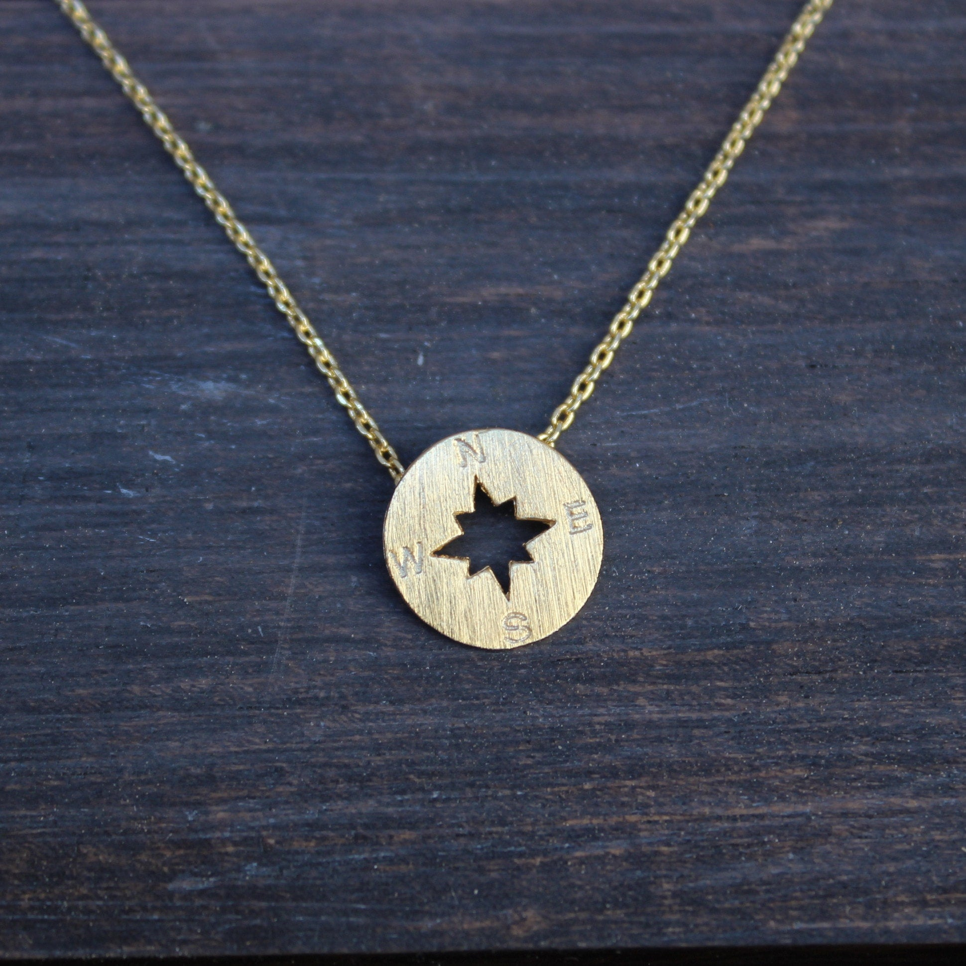 necklace and silver product wid sterling gold compass