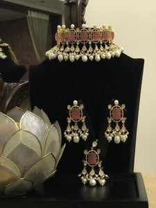 Choker with stones along with earrings and nethichutti