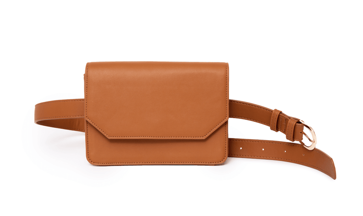 Brown convertible vegan leather 2-in-1 quarantine bag with belt, convertible to a hand bag. Pockets for hand sanitizer, key clip, and mask.
