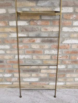 Load image into Gallery viewer, Antique bronze mirror ladder leant against a brick wall. interior design
