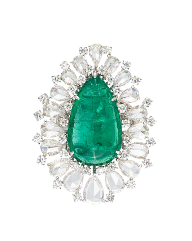 Cabochon emerald surrounded by round brilliant cut and rose cut diamonds, crafted in 18 karat white gold.