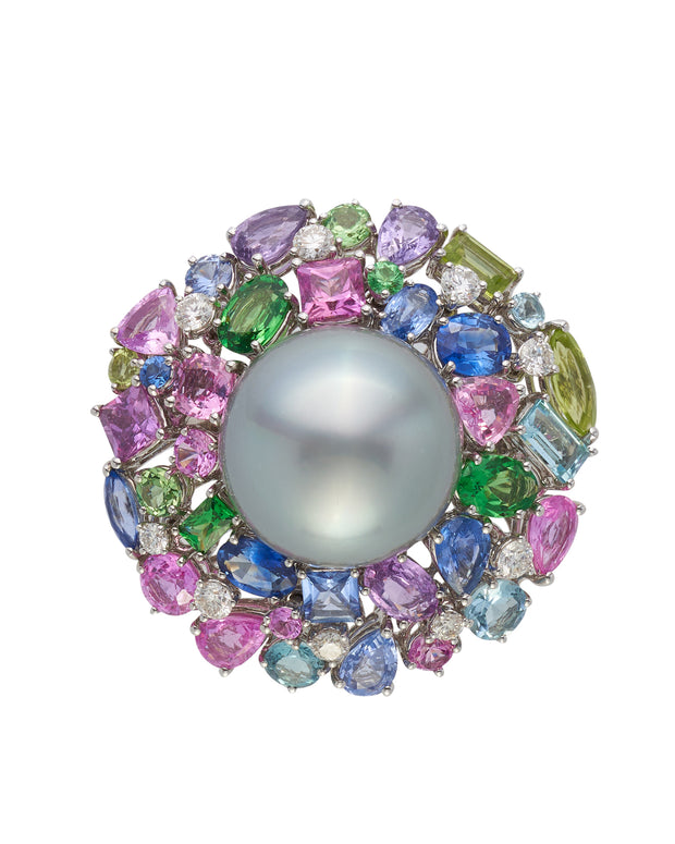 Tahitian pearl ring surounded by a myriad of gemstones, crafted in 18 karat white gold.