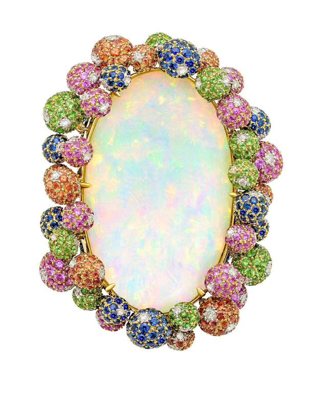 """en tremblant"" Ethiopian opal ring set with a myriad of gemstones, crafted in 18 karat yellow gold."