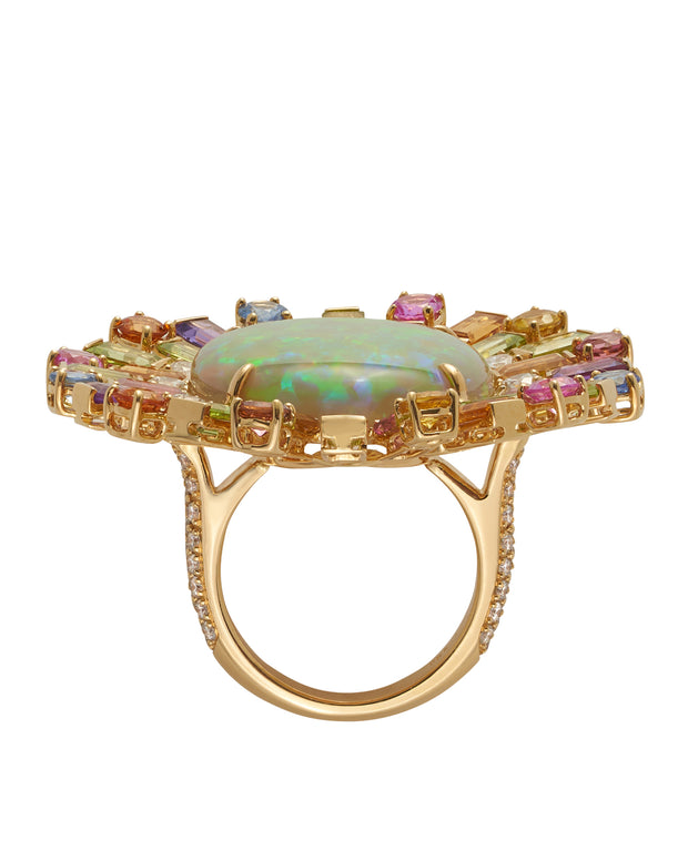 Solid natural Lightening Ridge opal, surrounded by a myriad of gemstones, crafted in 18 karat yellow gold.